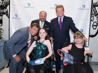 Former NY Jet and Hall of Famer, Joe Namath; Sports Night Chairman Bo Dietl; and NFL MVP & Super Bowl Champ Joe Theismann strike a pose with two students from the Henry Viscardi School at The Viscardi Center.