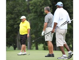 Three golfers