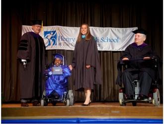 Graduation photo of John Kemp, Beth Daly and student, Aaron