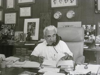 Dr. Henry Viscardi, Jr. at his desk