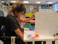 Tenzin S. painting a chair