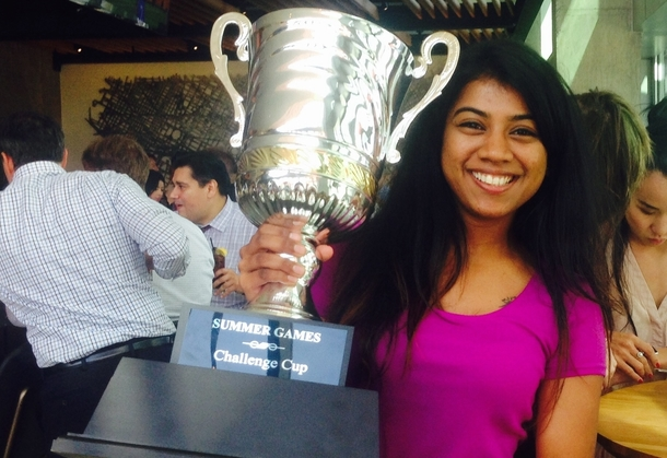 Nirath holding a trophy.