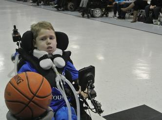 Dylan playing wheelchair basketball.
