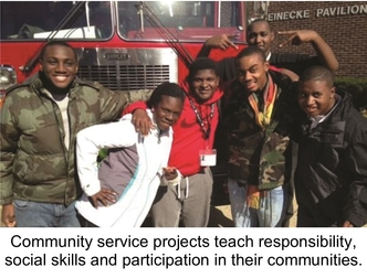 A group of six students infront of a firetruck. Community service projects teach responsibility, social skills and participation in their communities.