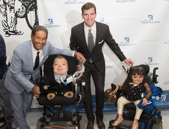 Bryant Gumbel and Eli Manning with students