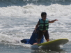 Keanu, a student at Henry Viscardi School, surfing.
