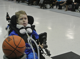 Dylan playing wheelchair basketball.