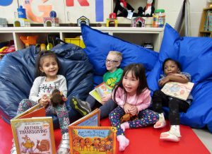 4 Viscardi School Kindergarten students on bean bags with books