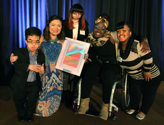 Students present Jenny DiNoia with artwork.