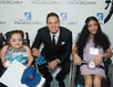 NY Met, Wilmer Flores, with two students.