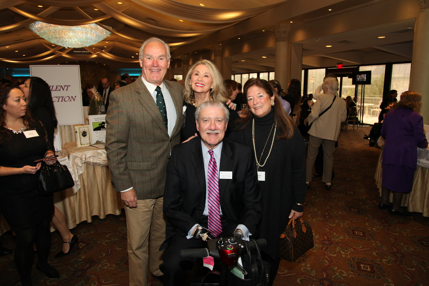 Viscardi President & CEO, John D. Kemp and his wife, Sam – a member of the Reach for a Star Luncheon Committee, with Bob and Deb Hussey during the event's cocktail reception.