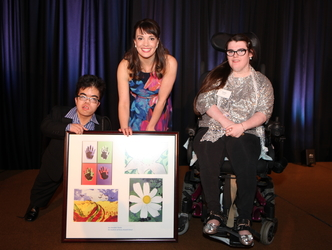 Students from Henry Viscardi School present Kara Lindsay with a montage of original artwork created by their classmates.