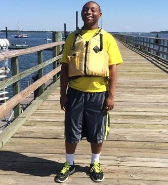 Boy on a pier.