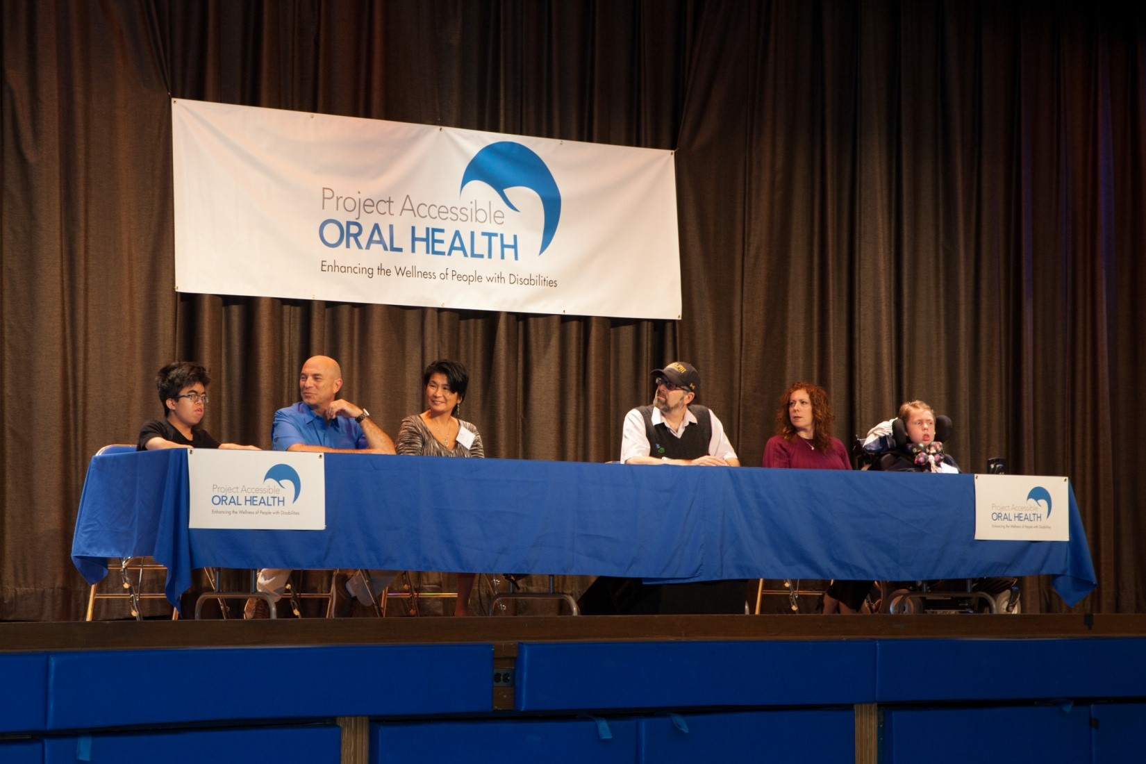 [L-R] Panelists Keanu, a student at the Henry Viscardi School at The Viscardi Center; his parents Doug Resnick and Elsie Low; Dr. Stephen Shore a globally renowned professor, author, speaker, advocate and individual on the autism spectrum; Debbie Cuevas mother to Dylan; and Dylan, a student at the Henry Viscardi School, explain the challenges they face in accessing oral healthcare.