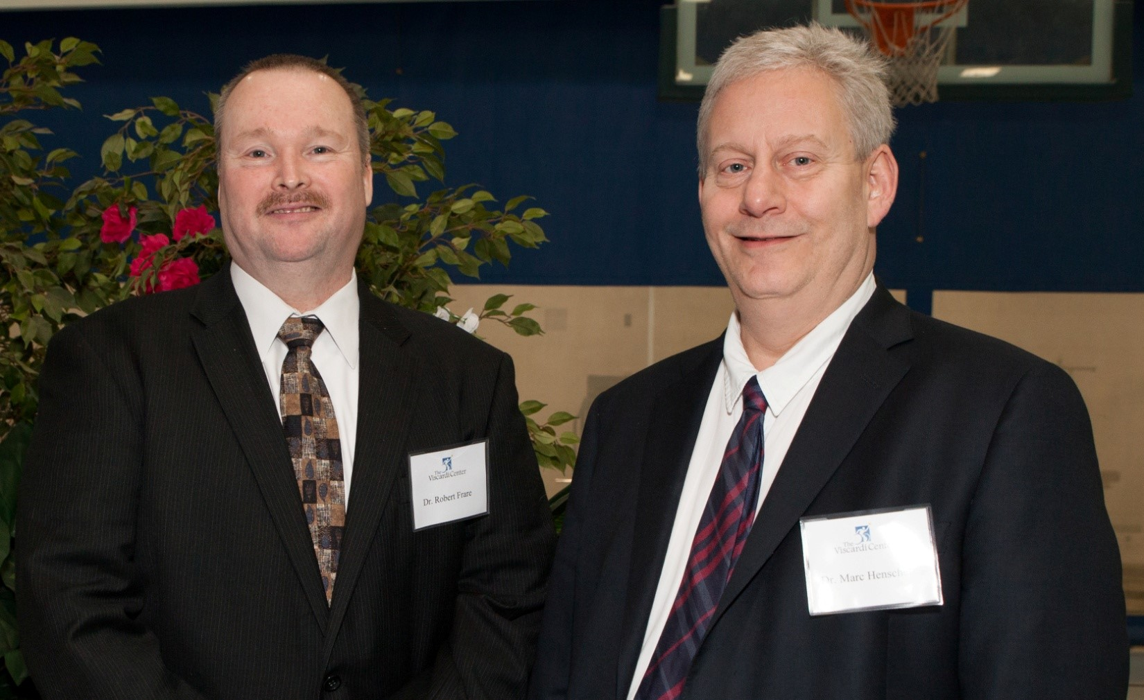 Dr. Robert Frar, Clinical Instructor, and Dr. Marc Henschel, Clinical Assistant Professor of the Oral and Maxillofacial Pathology, Radiology and Medicine Department at New York University, connect during the Project Accessible Oral Health event.