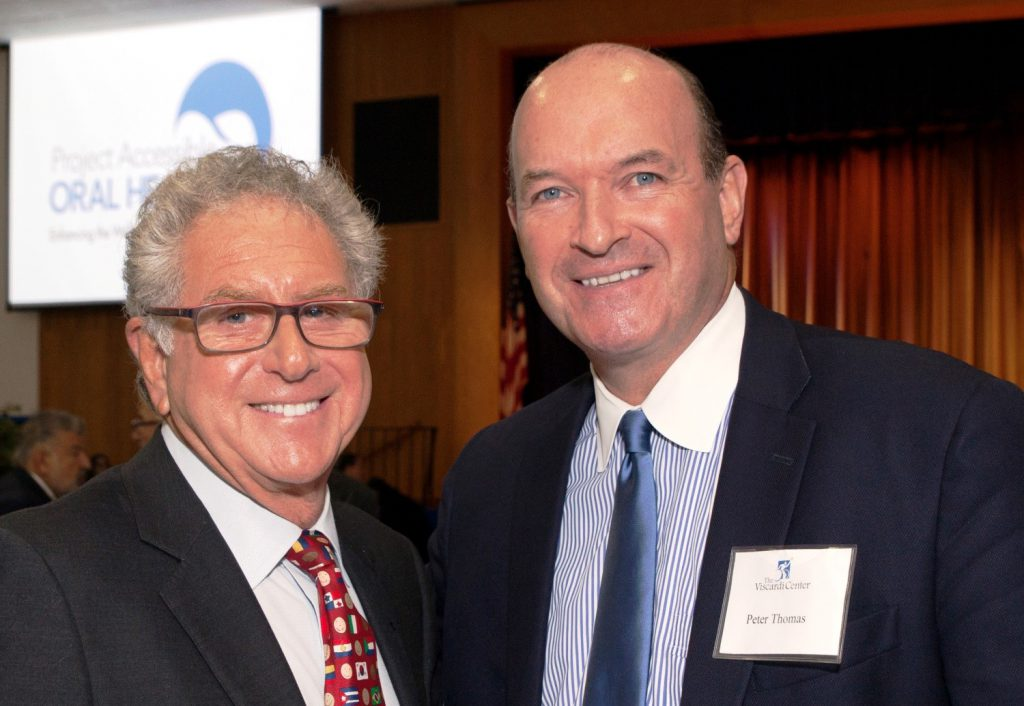 [L-R] Keynote speaker Dr. Steve Perlman of Special Olympics, Special Smiles and panel moderator Peter Thomas, Principal with Powers Law Group, share ideas at Project Accessible Oral Health.