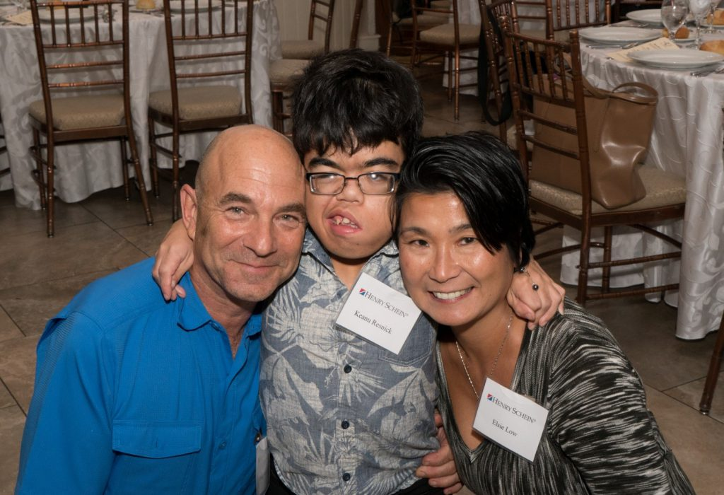 [L-R] Event Panelists and Parents, Doug Resnick and Elsie Low, with son Keanu, celebrate at Project Accessible Oral Health's Day 1 Dinner.