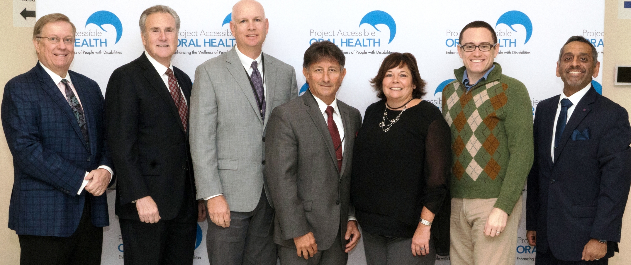 [L-R] Special Care Dentistry Association leadership gather to support Project Accessible Oral Health: Robert Patterson, Dr. Jeffrey L. Hicks, Dr. Stephen Beestra, Dr. David Miller, Dr. Maureen Perry, Dr. Scott Howell and Dr. Dhru Bhatt.