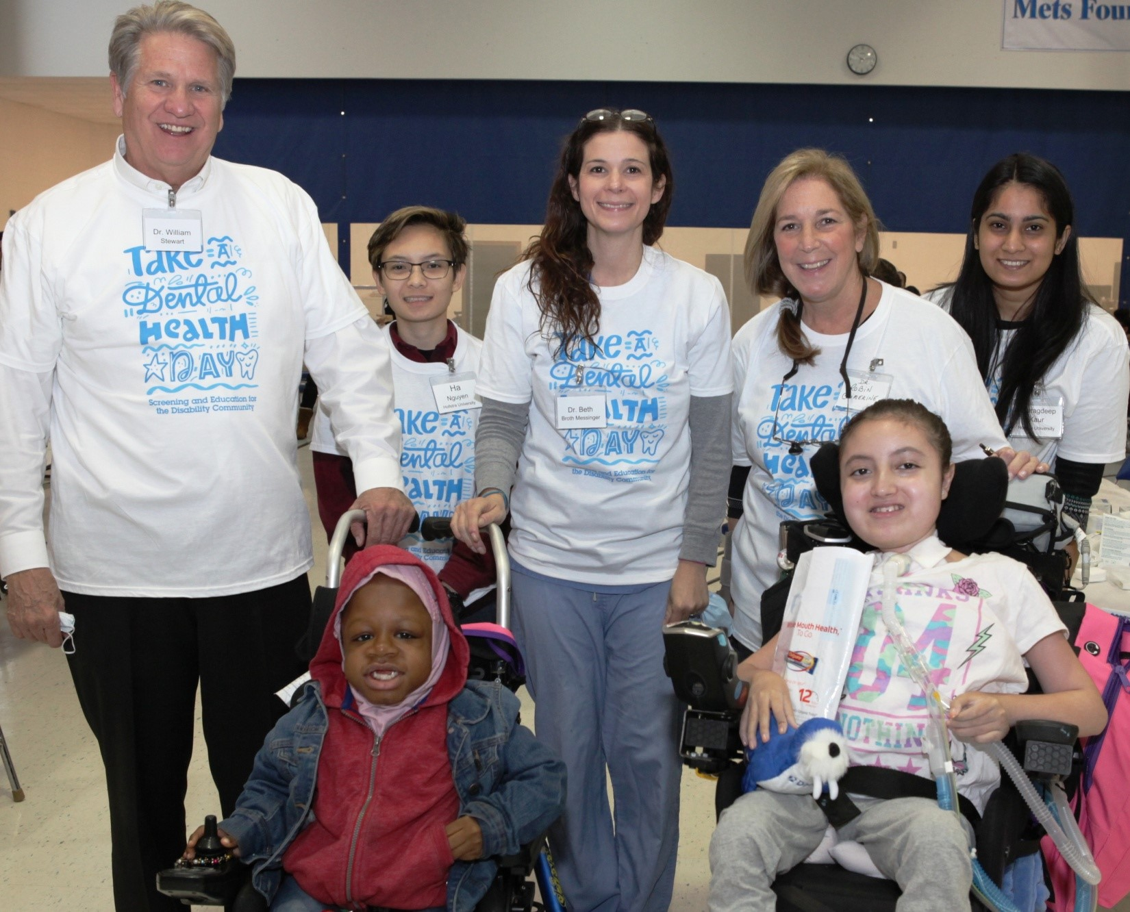 """[L-R Standing] Dr. William Stewart, Ha Nyugen, Dr. Beth Broth Messinger, Dr. Robin Cimerine and volunteers join together to screen and educate Henry Viscardi School students at Project Accessible Oral Health's """"Take a Dental Health Day: Screening and Education for the Disability Community."""" This first-ever event, which took place at The Viscardi Center in Albertson, New York on Friday, October 26, focused on raising awareness of the number one unmet health need for 57 million people with disabilities in America - access to culturally competent oral healthcare."""