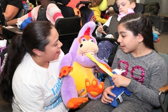 [L-R] Registered Dental Hygienist Yocelyn Arevalo educates Henry Viscardi School student, Jana, during Project Accessible Oral Health's inaugural