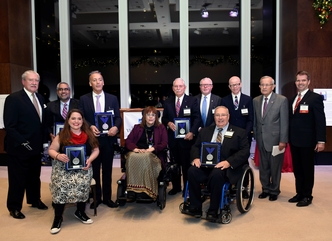 President and CEO, John D. Kemp and Board Chair, Russ Cusick, pose with this year's Henry Viscardi Achievement Award recipients during the awards ceremony hosted at Mutual of America in New York City.