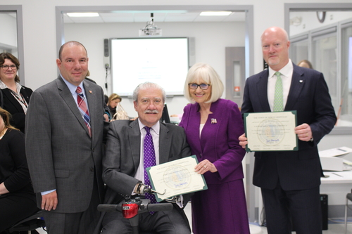 (l-r) Councilman Peter Zuckerman, John D. Kemp, Town of North Hempstead Supervisor Judi Bosworth, John Reilly, Senior Vice President of Global Managed Services, Canon Solutions America