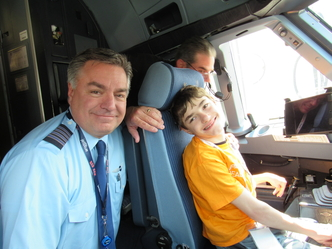 JetBlue pilot and male HVS student in cockpit of an airplane