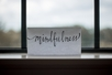"""A sign in a window that says, """"Mindfulness"""""""